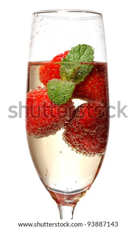 Glasses of sparkling wine and strawberry on white - stock photo