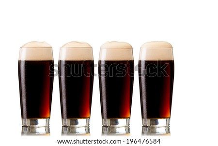 Glasses of stout beer, isolated on white  - stock photo