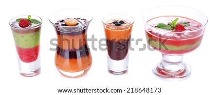 Glasses of tasty smoothies, isolated on white