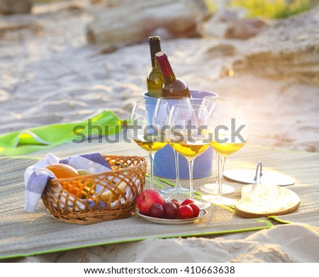 Glasses of the white wine on the beach summer picnic - stock photo