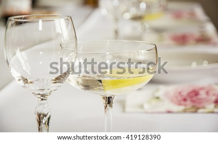 Glasses of vermouth with lemon for birthday party. Refreshments theme. Alcoholic drink. - stock photo