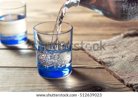 Glasses Of Water On A Wooden Table. Water Was Poured Into The Beaker.  Selective