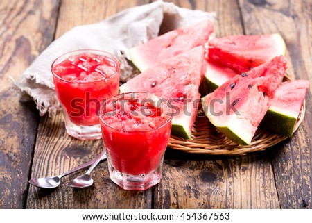 glasses of watermelon granita on wooden table