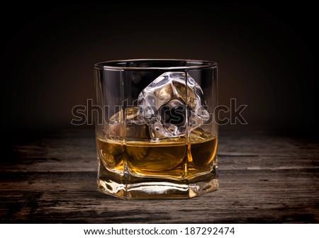 Glasses of whiskey on wood background. - stock photo