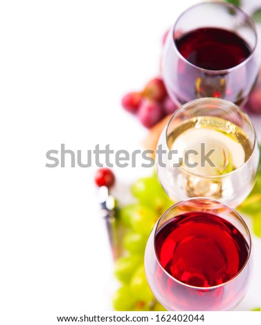 Glasses of white and rose wine and grapes - stock photo