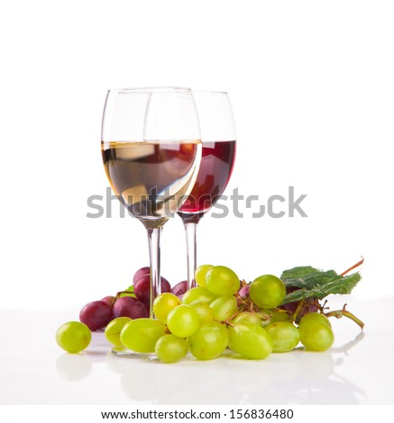 Glasses of white and rose wine and grapes isolated on white background  - stock photo