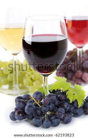 Glasses of white and rose wine and grapes over white - stock photo
