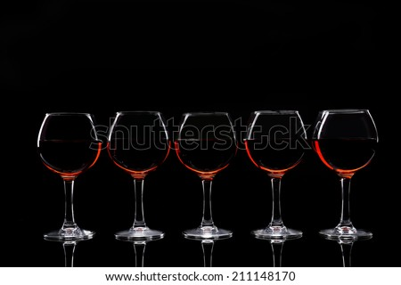 Glasses of wine isolated on black