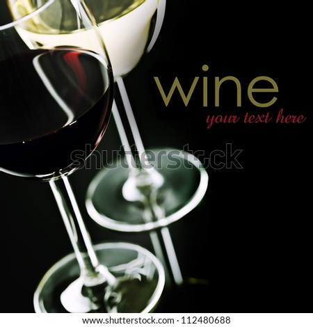 Glasses of  wine on black background  (easy removable sample text) - stock photo