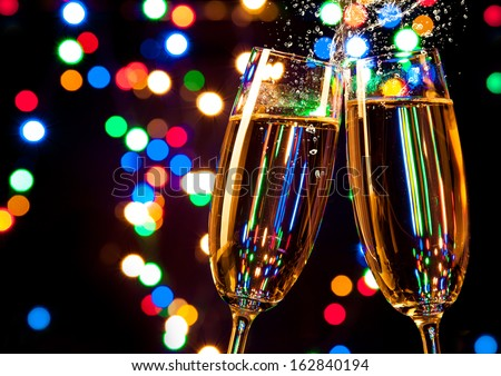Glasses of wine with blur light spots on background - stock photo
