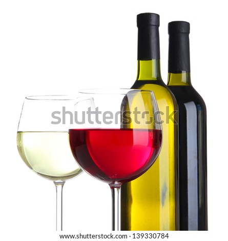 Glasses of wine with bottles isolated on white - stock photo