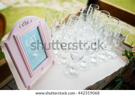glasses on a beautiful tray for guests at wedding - stock photo