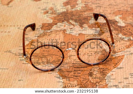 Glasses on a map of a world - Africa  - stock photo