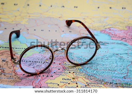 Glasses on a map of Asia - Afghanistan - stock photo