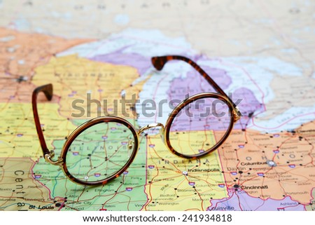Glasses on a map of USA - Illinois