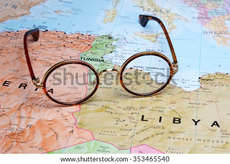 Glasses on a map - Tripoli  - stock photo
