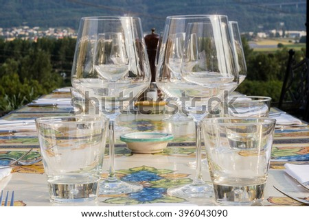 glasses on a table set for a wedding
