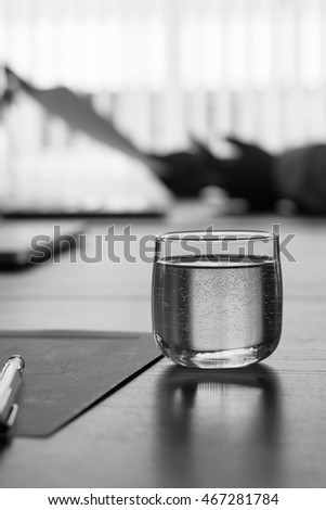 glasses on conference table in conference room with black and white tone.