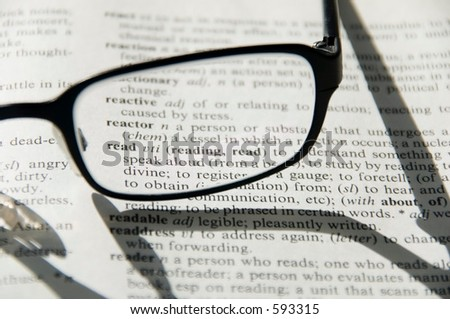 Glasses on dictionary, detail
