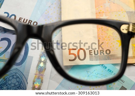 Glasses on euro notes