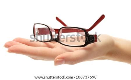 glasses on female hand, isolated on white - stock photo