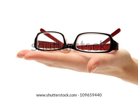 glasses on female hand, isolated on white - stock photo