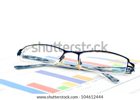 Glasses on financial graph - stock photo