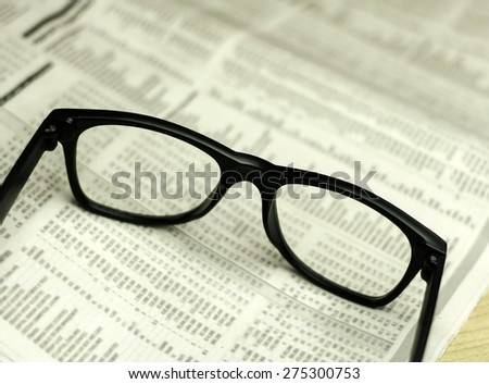 Glasses on newspaper. Macro  view with a very shallow depth of field with copy space for text