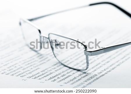 Glasses on newspaper. Toned - stock photo