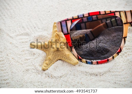 glasses on sand