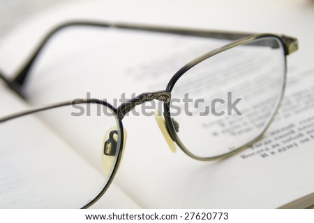 Glasses on the book. Macro shoting