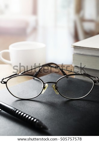 Glasses on the desk in the bedroom.