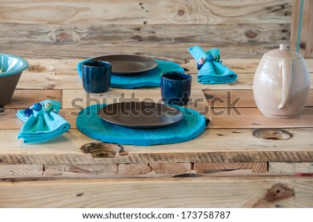 Glasses, plates and napkins on wood table