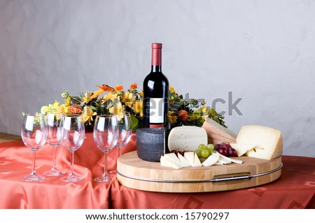 glasses, red wine and cheese - stock photo