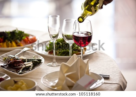 Glasses set with drinks in restaurant - stock photo