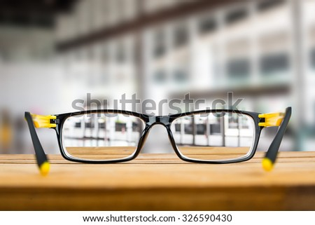 Glasses view vision focus viewpoint in office company. - stock photo