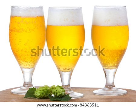 glasses with beer and hop on white background