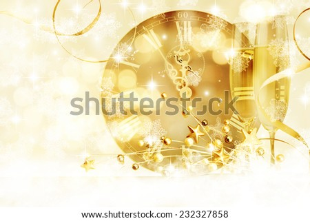 Glasses with champagne against clock close to midnight - stock photo