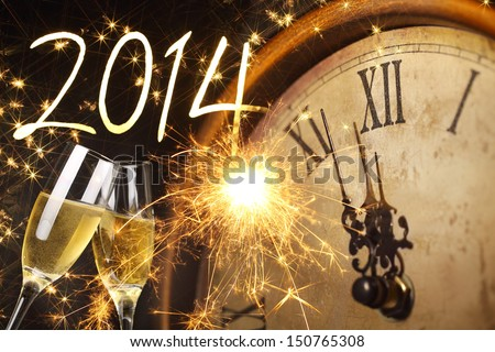 Glasses with champagne against fireworks and clock close to midnight 2014 - stock photo