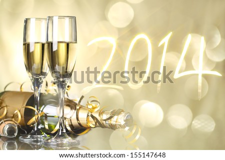 Glasses with champagne against fireworks,new year2014 - stock photo