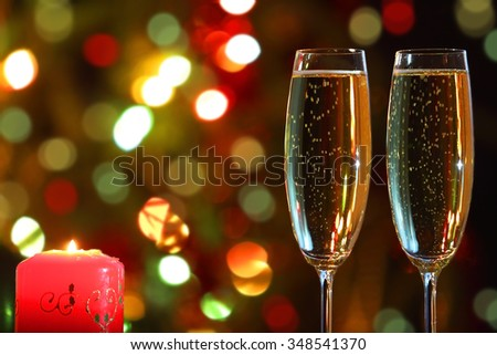 glasses with champagne and candle - romantic evening - stock photo