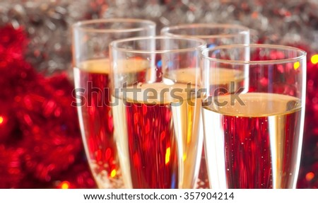 Glasses with champagne on the red background - stock photo