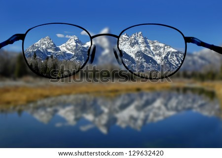 Glasses with clear vision of Teton Mountains in background - stock photo