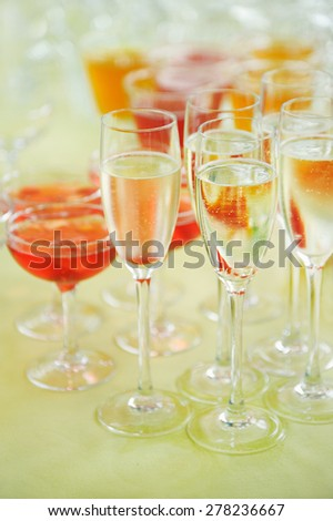 glasses with cocktail and wine
