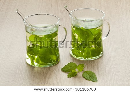 Glasses with fresh Melissa officinalis tea - stock photo