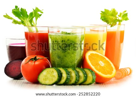 Glasses with fresh organic vegetable and fruit juices isolated on white. Detox diet. - stock photo