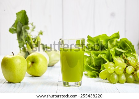 Glasses with fresh vegetable juices isolated on white table. Detox diet.