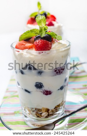 Glasses with  Fruit and Berry Parfait for Dessert - stock photo