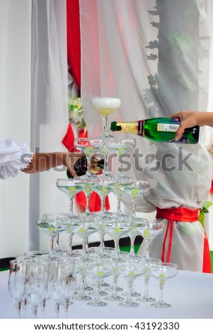 Glasses with grapes stand on a table in thepyramid form - stock photo