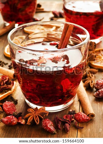 Glasses with hibiscus tea, spices and berries. Shallow dof.